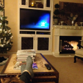 Relaxing after decorating the tree, with kitty on my lap and a fire blazing, music playing.
